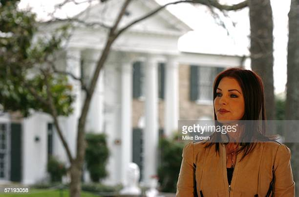 Priscilla Presley listens to Secretary of the Interior Gale Norton address a group of Elvis fans on the front lawn of Graceland March 27 2006 in...