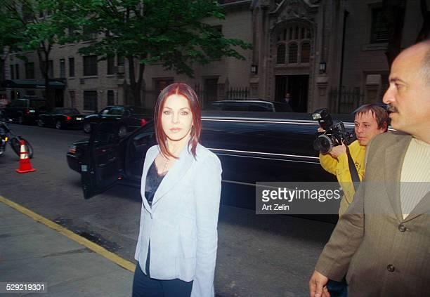 Priscilla Presley on the sidewalk limousine in the background circa 1990 New York