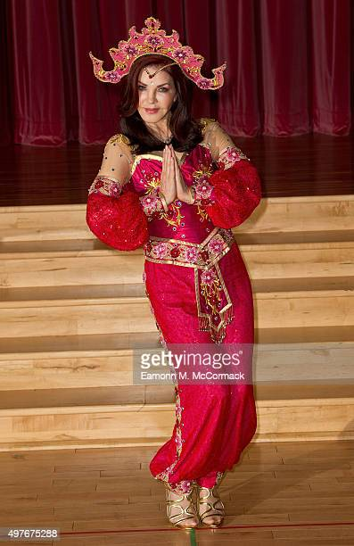 Priscilla Presley poses during a photocall for 'Aladdin' at Milton Keynes Theatre on November 18 2015 in Milton Keynes England
