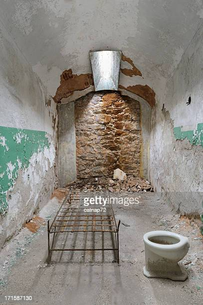 Prison Cell in Ruins with Bed and Toilet