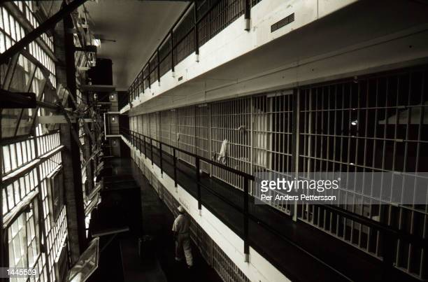 Prison cells line a hall at the Ellis death row unit April 16 1997 in Huntsville Prison in Huntsville Texas The state has about 450 prisoners on...