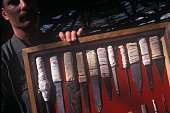 Prison guard Jim Bales at Old Folsom State Prison holds up a display of illegal weapons or 'shanks' confiscated from prisoners Folsom State Prison in...