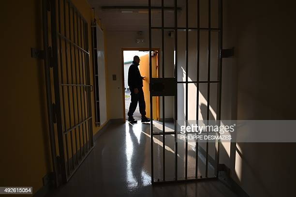 A prison guard open a door during a press visit on October 14 2015 in the new prison in Valence southeastern France This prison has been built as...