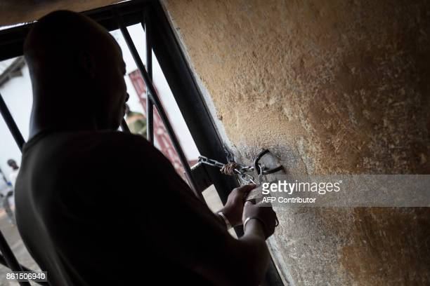 A prison guard opens a door at the Bouar detention centre in Bouar western Central African Republic on October 13 2017 In the Central African...