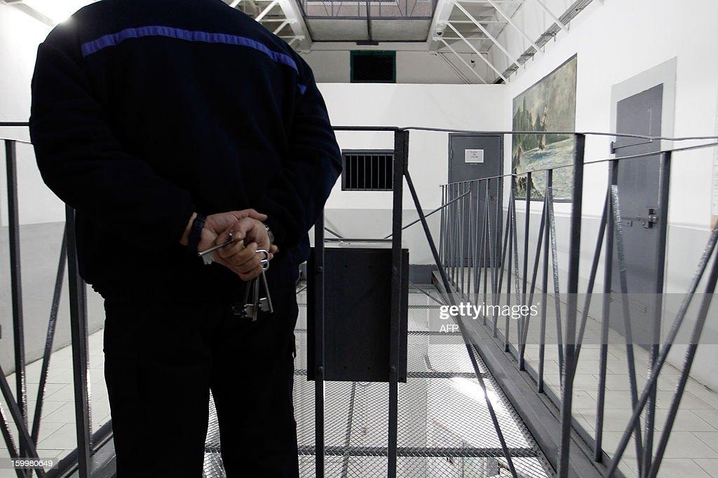 A prison guard stands guard on a corridor at the Ajaccio's jail on January 24, 2013, in Ajaccio, Corsica.