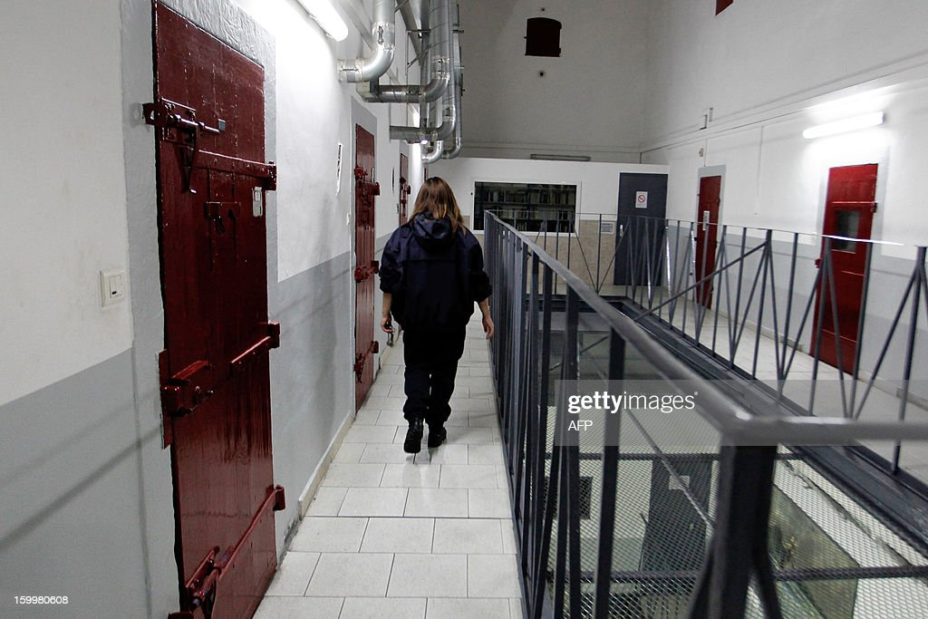 A prison guard walks through a corridor at the Ajaccio's jail on January 24, 2013, in Ajaccio, Corsica. AFP PHOTO / PASCAL POCHARD-CASABIANCA