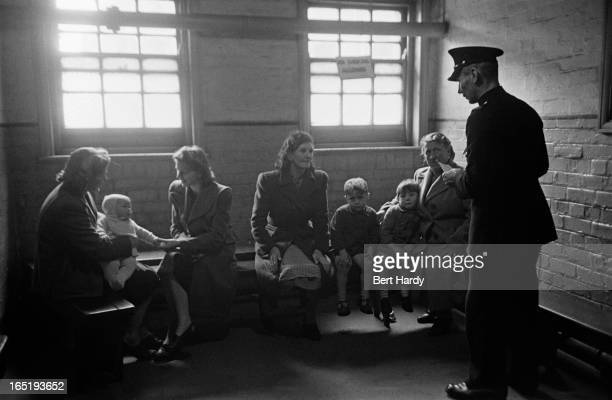 Prison officer Davidson talks to a group of visitors at Strangeways Prison in Manchester November 1948 Original publication Picture Post 4682 The...