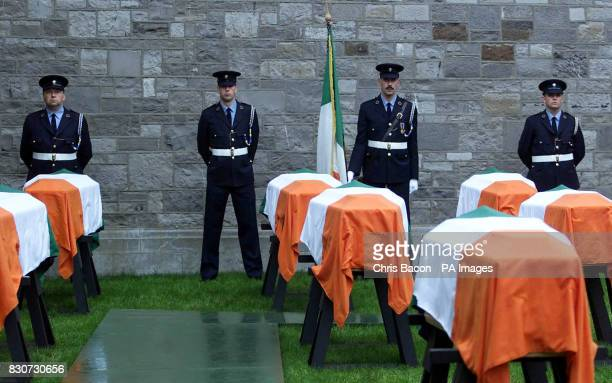 Prison officers guard the coffins of 10 War of Independence volunteers in Mountjoy Prison Dublin Thousands of people lined the streets of Dublin to...