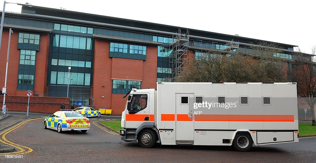A prison van arrives outside Preston Crown Court in Preston, north-west England on February 7, 2013, ahead of the start of the trial in which Dale Cregan stands charged with the murder of WPC Fiona Bone, her colleague WPC Nicola Hughes and two other people. The trial includes nine other people.