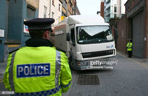 A prison van believed to contain the 17yearold teenager accused of murdering schoolboy Rhys Jones arrives under police escort at Liverpool...