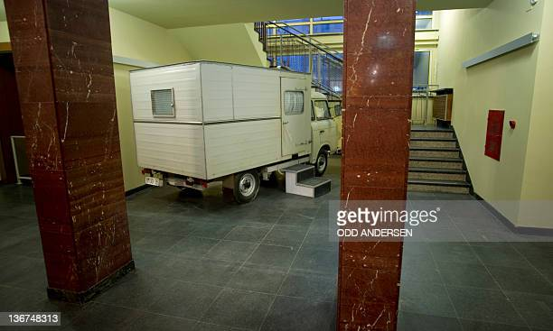 A prison van is seen at the entrance of the defunct East German secret police Stasi headquarters turned museum in Berlin on January 11 2012The...