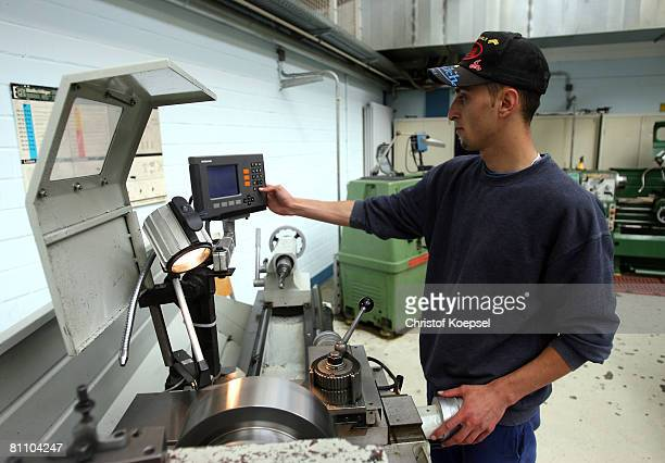 Prisoner Atif works to be a professional machinist at the Iserlohn prison on May 15 2008 in Iserlohn Germany The prison in North RhineWestphalia...
