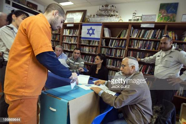 A prisoner cast his vote on January 22 at a polling station setup in the Hasharon prison in Hadarim centeral Israel Israelis voted in elections...