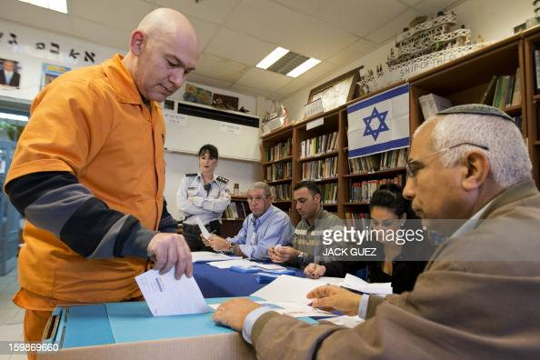 A prisoner casts his ballot on January 22 at a polling station setup in the Hasharon prison in Hadarim centeral Israel Israelis voted in elections...