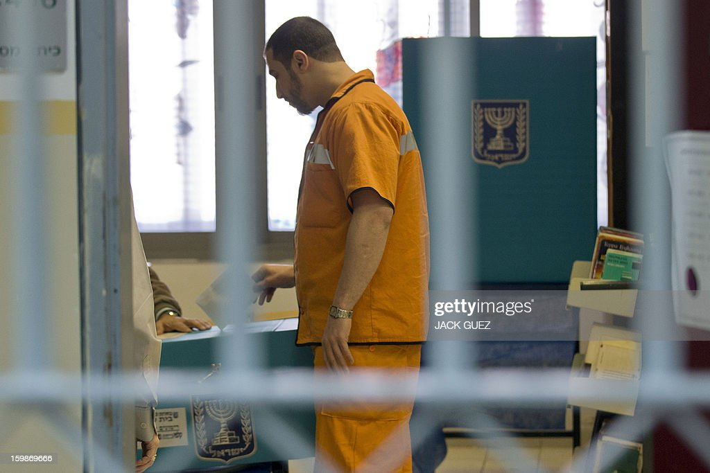 A prisoner casts his ballot on January 22, 2013, at a polling station set-up in the Hasharon prison in Hadarim, centeral Israel. Israelis voted in elections likely to return Prime Minister Benjamin Netanyahu as head of a rightwing coalition that will face the challenges of peacemaking with the Palestinians and Iran's nuclear programme. AFP PHOTO / JACK GUEZ