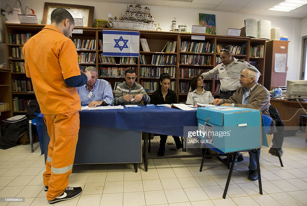 A prisoner has his name checked on a register as he waits to cast his ballot on January 22, 2013, at a polling station in the Hasharon prison in Hadarim, centeral Israel. Israelis voted in elections likely to return Prime Minister Benjamin Netanyahu as head of a rightwing coalition that will face the challenges of peacemaking with the Palestinians and Iran's nuclear programme. AFP PHOTO / JACK GUEZ