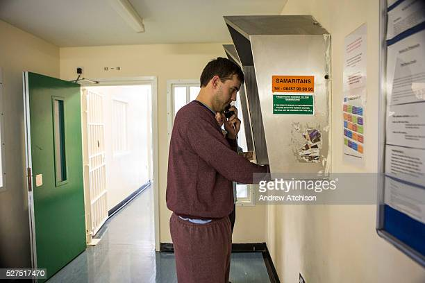 A prisoner makes a call home to family HMP/YOI Portland Dorset A resettlement prison with a capacity for 530 prisoners Dorset United Kingdom
