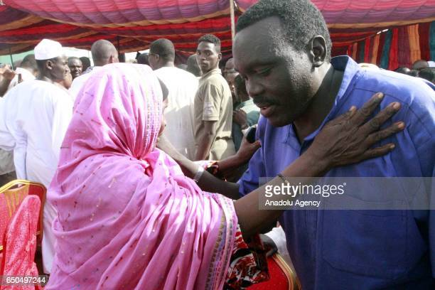 A prisoner meets with his relative after being released in Khartoum Sudan on March 9 2017 259 prisoners including people who were sentenced to death...