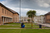 A prisoner next to a palm tree tends to the prison garden HMP YOI Littlehey Littlehey is a purpose build category C prison