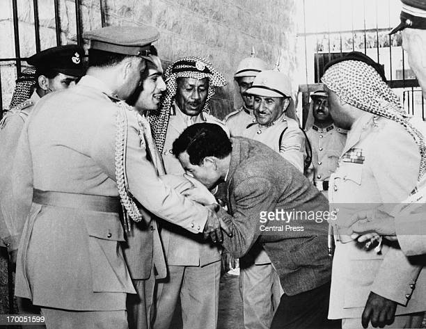 A prisoner rushes forward to kiss the hand of King Hussein of Jordan when the King made an unexpected visit to Amman Central Prison Jordan 24th May...