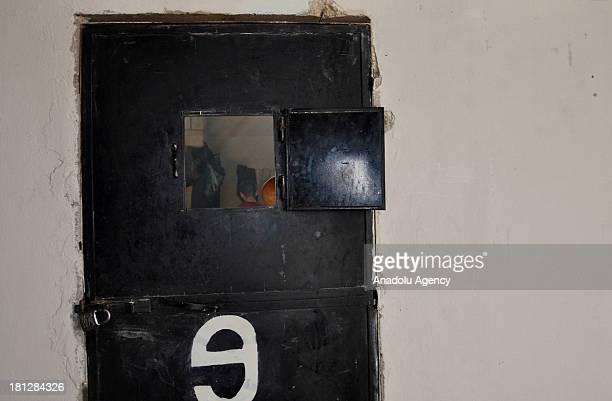 A prisoner seen through the door window of a cell at the prison in Aleppo on August 21 2013 in AleppoSyria The Aleppo prison in the Al Ray building...
