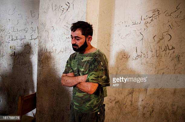 A prisoner stands inside the jail of a temporary Islamic court in the rebelcontrolled town of alBab 30 kilometres northeast of Aleppo on September 5...