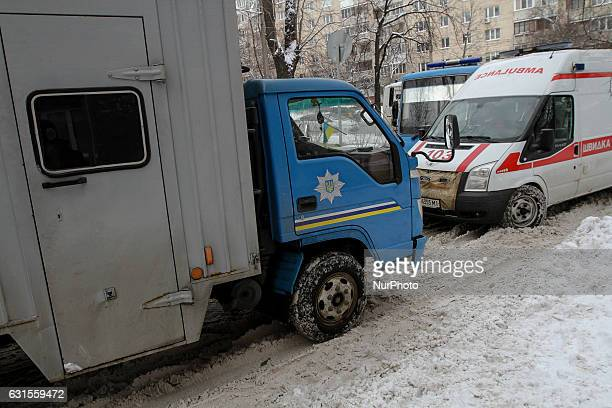 A Prisoner transport vehicle passes an Ambulance as it drives out of a Lukyanivske PTDC where a prisoner cut his ear to protest overnight into...