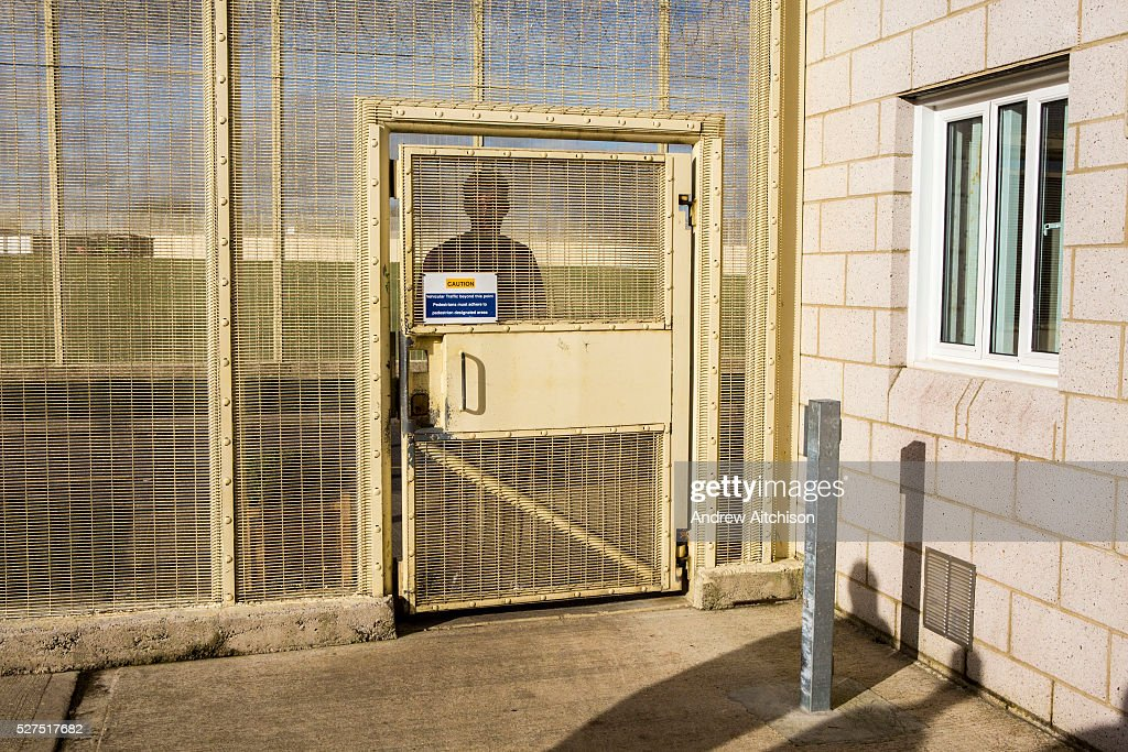 A prisoner waits outside his wing secured door to return to his cell HMP/YOI & Prison Door Lock Stock Photos and Pictures   Getty Images Pezcame.Com