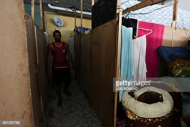 A prisoner walks among bedrooms in Villahermosa jail in Cali Colombia on May 12 2016 Secretary of Health and prison authorities began sessions of...