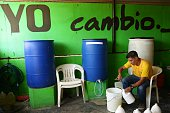 A prisoner works at a detergent factory of the Apanteos prison in Santa Ana 66 km west of San Salvador on July 15 2016 Apanteos is a model prison in...
