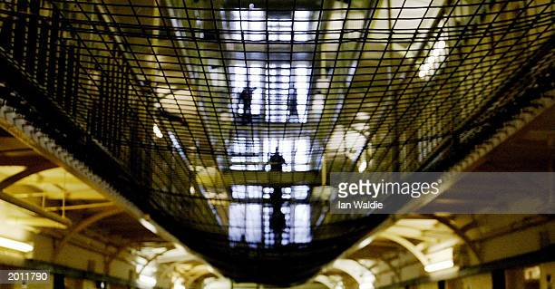 Prisoners at HMP Pentonville walk through an atrium May 19 2003 in London A new report from the Prison Reform Trust says overcrowding in Britain's...