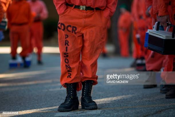 Prisoners at Oak Glen Conservation Camp line up for work deployment under under the authority of Cal Fire during which time they are called and...