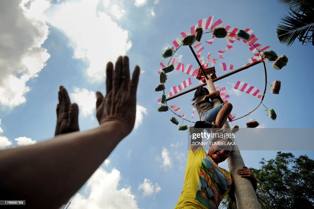 Prisoners climb a pole as they participate in official ceremonies and games marking Indonesia's 68th Independence Day at Kerobokan prison in Denpasar on Indonesia's resort island of Bali on August 17, 2013. Indonesia officials annually offer remissions to some prison sentences on the country's Independence Day for good behaviour. Bali's notorious Kerobokan prison is well known as the place holding several foreign inmates held for high-profile drugs offences.