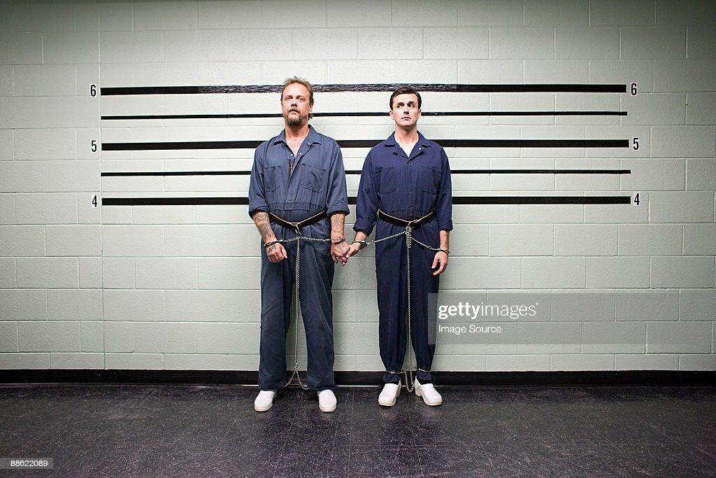 Prisoners holding hands