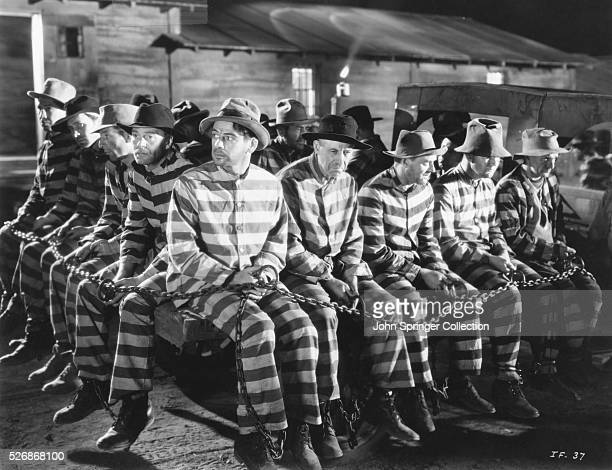 Prisoners in a chain gang at a prison in the 1932 film I Am a Fugitive From a Chain Gang Wrongly convicted James Allen played by Paul Muni serves in...