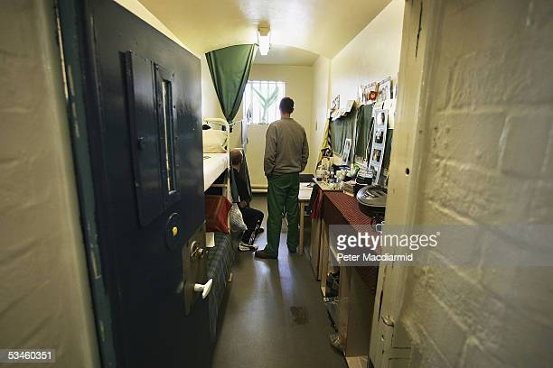 Prisoners look towards a window in a cell in A Wing of Norwich Prison on August 25 2005 in Norwich England A Chief Inspector of Prisons report on...