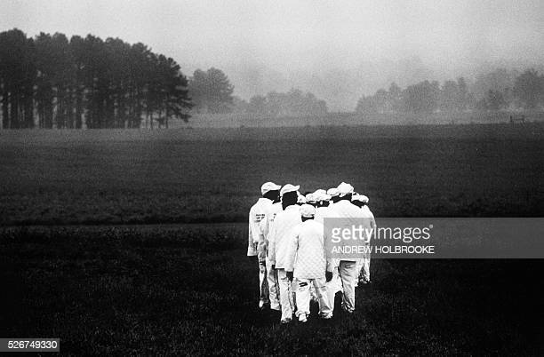 Prisoners on a chain gang at Limestone Correctional Facility go out to work in the early morning mist | Location Harvest Alabama United States