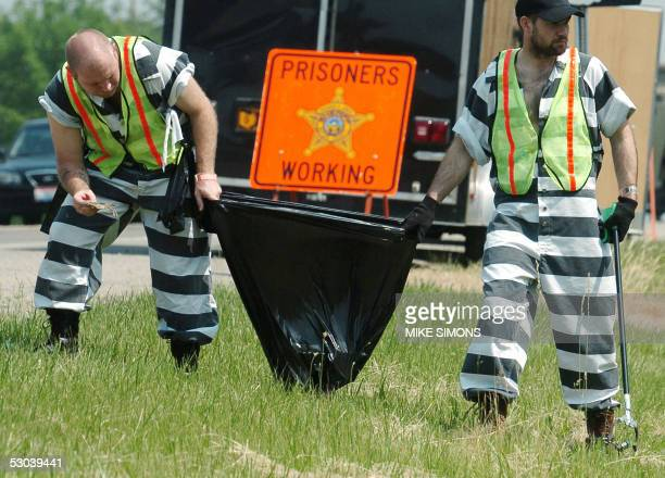 Prisoners pick up trash as part of the Bulter County Jail chain gain 07 June 2005 in Butler County Ohio Forty prisoners at the facility have...