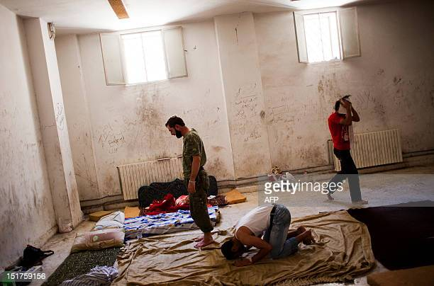 Prisoners pray inside the jail of a temporary Islamic court in the rebelcontrolled town of alBab 30 kilometres northeast of Aleppo on September 5...