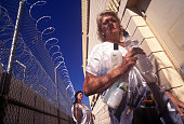 Prisoners return from the showers area at Estrella Jail Tent City in Phoenix AZ set up by Maricopa County Sheriff Joe Arpaio with surplus military...