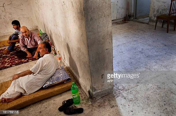 Prisoners sit inside the jail of a temporary Islamic court in the rebelcontrolled town of alBab 30 kilometres northeast of Aleppo on September 5 2012...