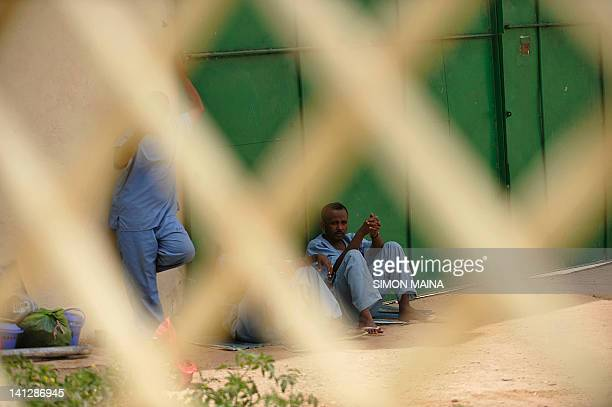 Prisoners sit on March 8 2012 in Hargesia's newlyrefurbished prison in the northern breakaway nation of wartorn Somalia Officers inside the jail were...