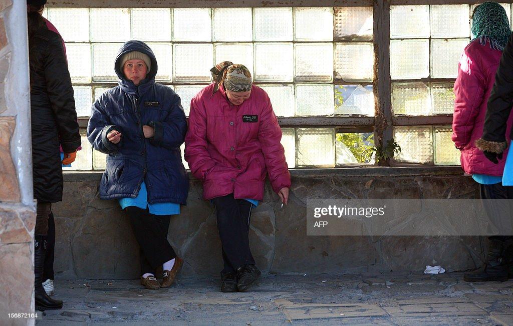 Prisoners smoke during a break in a women's penal colony in the industrial Ukrainian city of Mariupol, some 700 km southeast of the capital Kiev, on November 22, 2012.