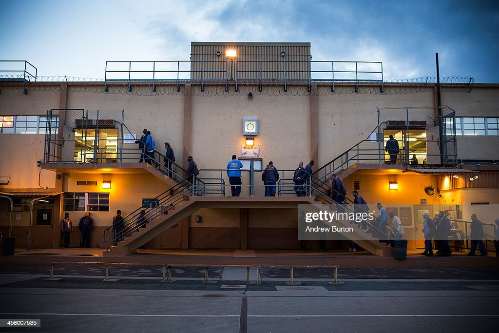 Prisoners wait in line for breakfast at California Men's Colony prison on December 19 2013 in San Luis Obispo California As of June 2013 the state of...