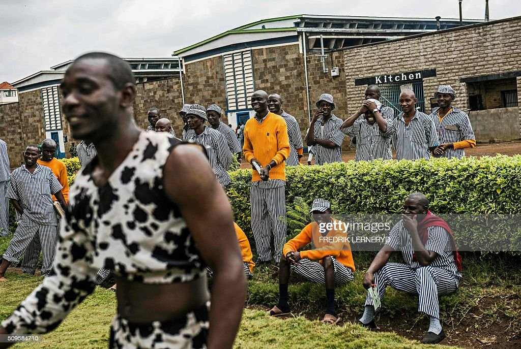 Prisoners watch an acrobatic workshop with the Sarakasi circus performers at Kamiti prison, Nairobi February 11, 2016. Sarakasi Circus performes dance, acrobatics and workshops for the inmates at Kamiti maximum security prison in order provide another form of engagement during their incarceration. / AFP / FREDRIK LERNERYD