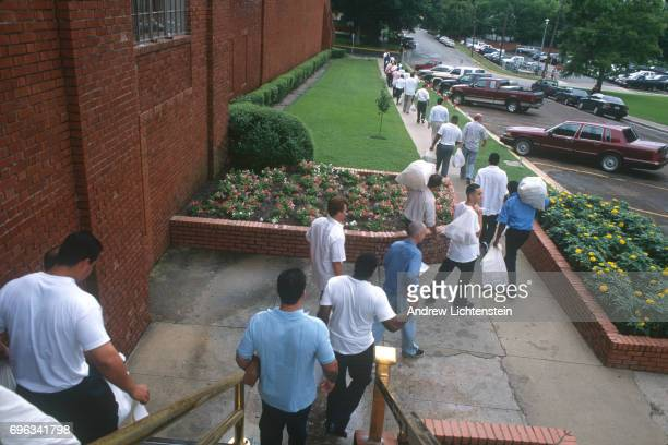 Prisoners who have finished their sentences are released from the Walls Unit on May 1 1997 in Huntsville Texas They are bused from all across the...