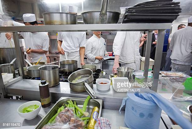 Prisoners work in the kitchen at the Clink Restaurant ahead of the lunch service inside Brixton Prison in south London on March 15 2016 Accessed...