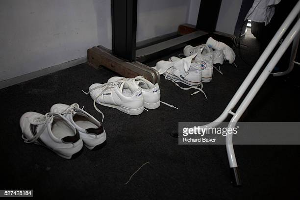 Pristine and spotlessly white Reebock and Converse footwear and stagewear belonging to the rock guitarist Francis Rossi of Status Quo are laid out on...