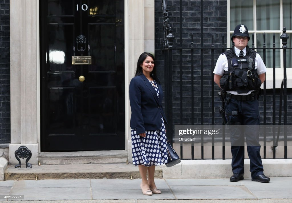 <a gi-track='captionPersonalityLinkClicked' href=/galleries/search?phrase=Priti+Patel&family=editorial&specificpeople=7114708 ng-click='$event.stopPropagation()'>Priti Patel</a>, the new Exchequer Secretary at the Treasury, departs Downing Street on July 15, 2014 in London, England. British Prime Minister David Cameron is conducting a reshuffle of his Cabinet team with a greater number of women expected to be appointed to senior positions.