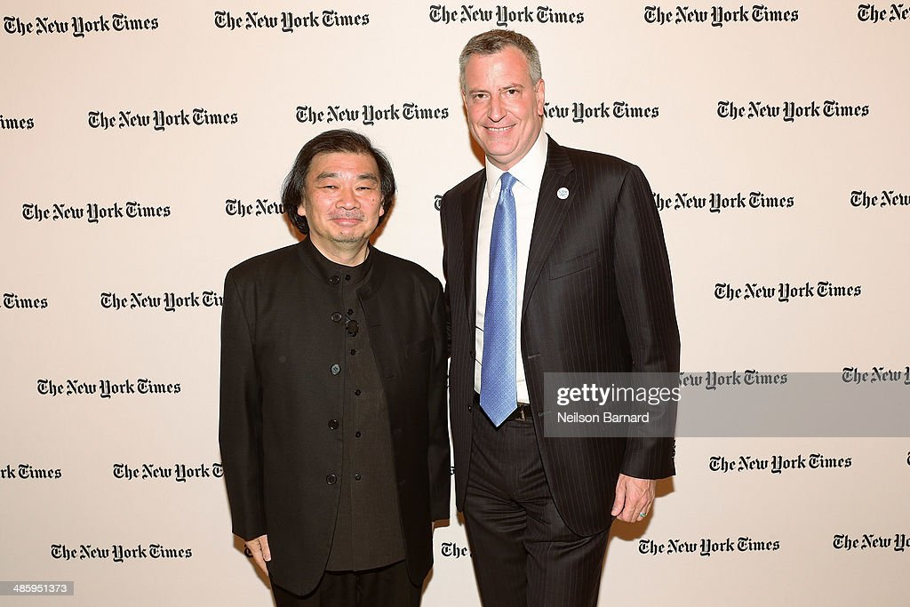 Pritzker Prize-winning architect <a gi-track='captionPersonalityLinkClicked' href=/galleries/search?phrase=Shigeru+Ban&family=editorial&specificpeople=2094801 ng-click='$event.stopPropagation()'>Shigeru Ban</a> (L) and Mayor of New York City <a gi-track='captionPersonalityLinkClicked' href=/galleries/search?phrase=Bill+de+Blasio&family=editorial&specificpeople=6224514 ng-click='$event.stopPropagation()'>Bill de Blasio</a> attend the cocktail reception for the New York Times Cities for Tomorrow Conference on April 21, 2014 in New York City.